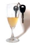 Claves del coche dentro de la flauta de champán Fotografía de archivo