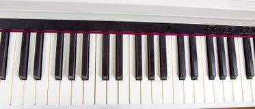 Claves electr?nicos del piano Afición de los instrumentos musicales foto de archivo