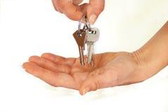 Claves en manos Foto de archivo libre de regalías