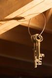 Claves que cuelgan de los vigas (verticales) Imágenes de archivo libres de regalías