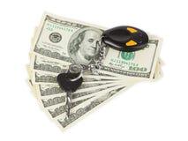 Claves y dinero del coche foto de archivo libre de regalías