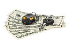 Claves y dinero del coche Imagen de archivo libre de regalías
