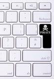 Clavier avec le mot et le symbole de pirate Photographie stock libre de droits