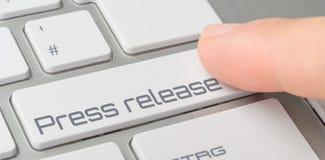 Clavier avec un bouton marqué - communiqué de presse images stock