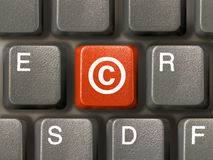 Clavier, clé avec copyright photos stock