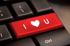 Clavier d'ordinateur avec la clé d'amour Photos stock