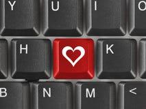 Clavier d'ordinateur avec la clé d'amour Image libre de droits