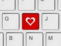 Clavier d'ordinateur avec la clé d'amour Image stock
