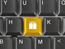 Clavier d'ordinateur avec la clé de cadeau Photo stock
