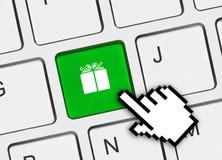 Clavier d'ordinateur avec la clé de cadeau Photos libres de droits