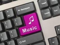 Clavier d'ordinateur avec la clé de musique photographie stock libre de droits