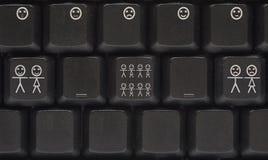 Clavier d'ordinateur avec la clé de sourire Photos stock