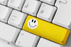 Clavier d'ordinateur avec la clé de sourire Images stock