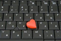 Clavier d'ordinateur avec le coeur Photos stock