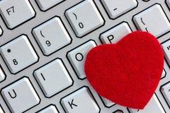 Clavier d'ordinateur avec le coeur Images stock