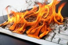 Clavier d'ordinateur brûlant Photographie stock libre de droits