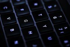 Clavier d'ordinateur dans rétro-éclairé Photographie stock