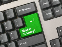 Clavier - la clé verte gagnent l'argent Photographie stock libre de droits