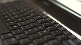 Clavier noir d'ordinateur portable banque de vidéos