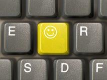 Clavier (plan rapproché) avec la clé de sourire Photos libres de droits