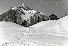 Claviere, Italy -  March 1939 Alpine cabin Gimont, and snow trac Royalty Free Stock Photos