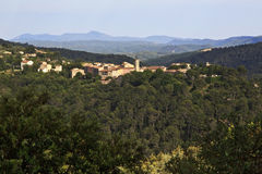 Claviers nestled amoungst the forests of the Var. Beautiful French mountain village of Claviers nestled between the trees of the thickly forested Var, France Stock Photos