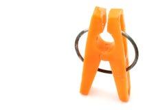 Clavija de ropa anaranjada Fotografía de archivo