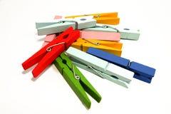 Clavijas de madera coloridas del paño foto de archivo