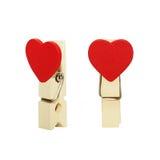 clavijas de madera del paño aisladas en blanco Foto de archivo libre de regalías