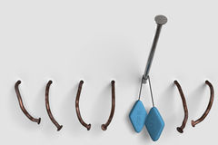 Clavo con las píldoras azules. Imagenes de archivo