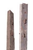 Clavo oxidado en la madera de la grieta en la trayectoria de recortes blanca del fondo Fotografía de archivo libre de regalías