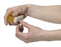 Clavos de la limpieza con un depurador Foto de archivo libre de regalías