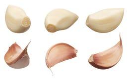 Clavos del ajo pelados y sin pelar en diversos ángulos Foto de archivo libre de regalías