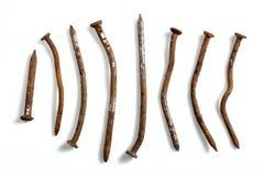 Clavos torcidos y oxidados Fotografía de archivo libre de regalías