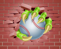 Claw with Baseball Ball Breaking Through Brick Wall Royalty Free Stock Photo