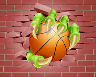 Claw with Basket Ball Breaking Through Brick Wall Royalty Free Stock Photo