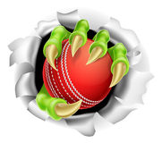 Claw with Cricket Ball Breaking out Of Background Royalty Free Stock Image