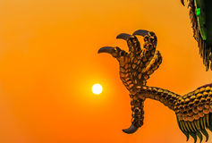 Claw of dragon statue. Against sunset royalty free stock photos