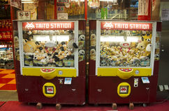 Claw Game or cabinet catches the doll japanese called Kureen gee. Mu in arcade area for people playing at Ameyoko market at Ueno on October 20, 2016 in Tokyo Royalty Free Stock Photography