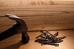 Claw Hammer And Nails On Wood Boards Stock Images