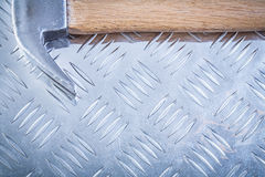 Claw hammer on channeled metal sheet horizontal version construc Royalty Free Stock Photo