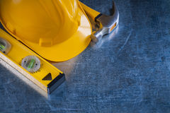 Claw hammer construction level and building helmet Royalty Free Stock Image