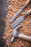 Claw hammer firmer chisels and wooden scobs on Royalty Free Stock Photos