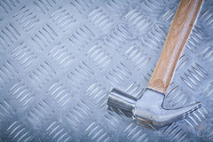 Claw hammer on grooved metal sheet top view construction concept.  Stock Photo