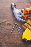 Claw hammer nails tapeline wooden meter nippers on Stock Photography