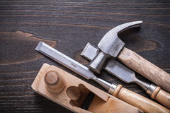 Claw hammer planer and firmer chisels on vintage. Wooden board construction concept Stock Photo