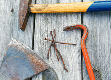 Claw hammer and rusty nails on the  boards Royalty Free Stock Images