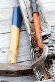 Claw hammer and rusty nails on the  boards Royalty Free Stock Image