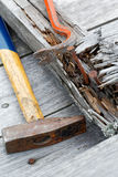 Claw hammer and rusty nails on the  boards Royalty Free Stock Photo