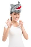 Claw-like gesture. Woman in a wolf mask with hands raised in claw-like gesture Stock Image